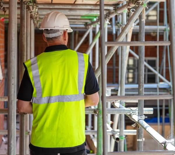 Builder on a construction site wearing a hi-vis jacket